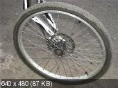 Полноподвесный велосипед с консольным креплением колёс Зёбра